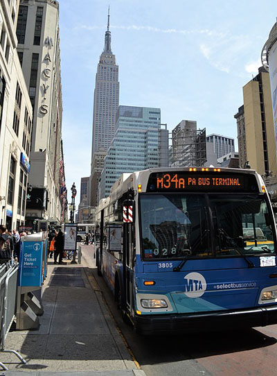 NY MTA Metro Area Bus with Empire State Building in background