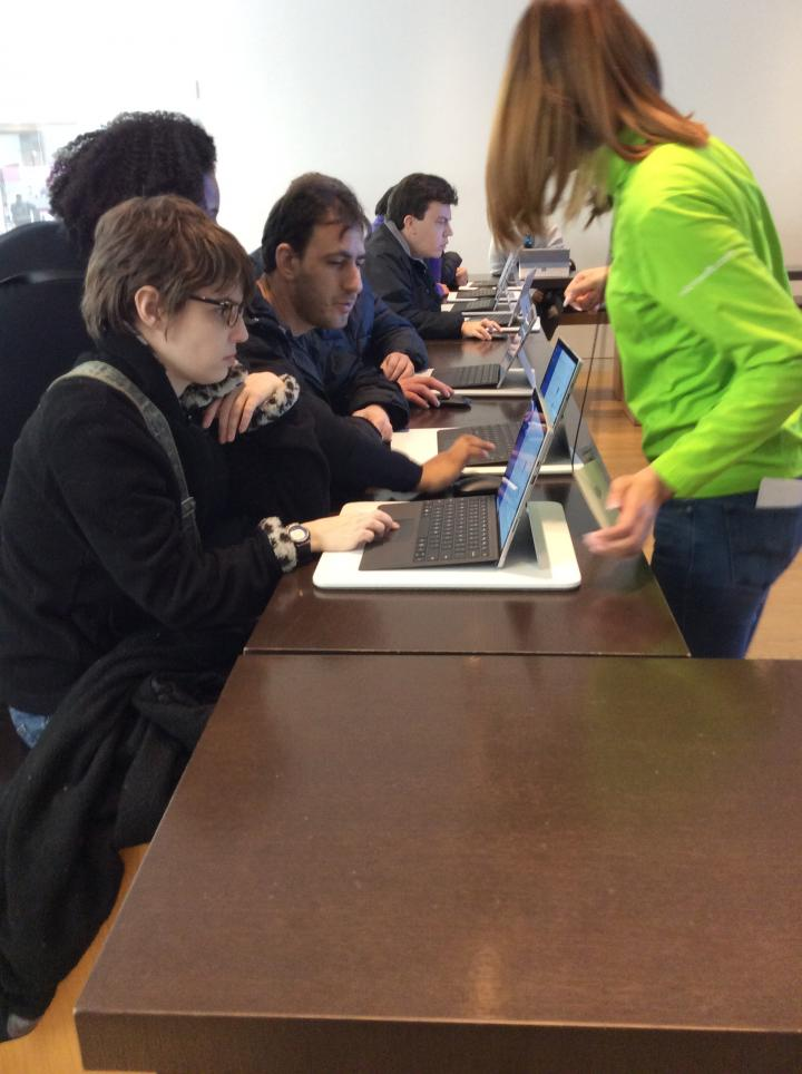 Photograph of people sitting at computers