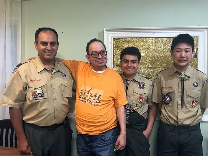 Resident introduces the Boy Scouts to his housemates at YAI's Alan Butger residence.