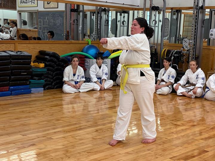 photo: Advanced yellow belt, Jennifer Naftelowitz, practicing her karate moves