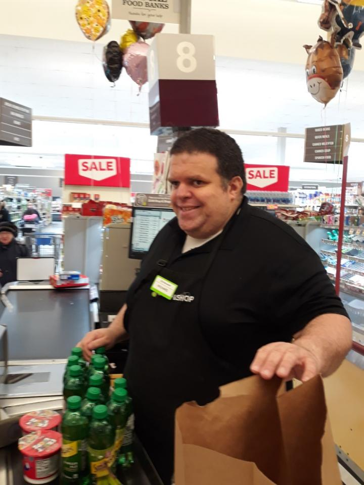 Richard working at a cash register