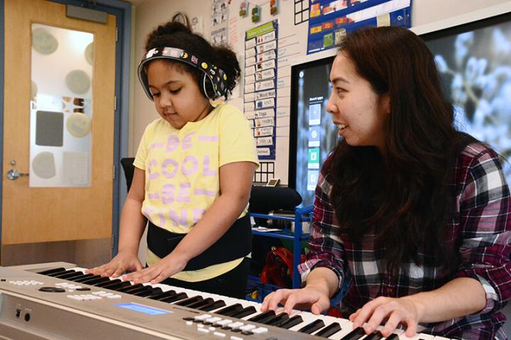 Student playing keyboard with MSA's Musical Therapist