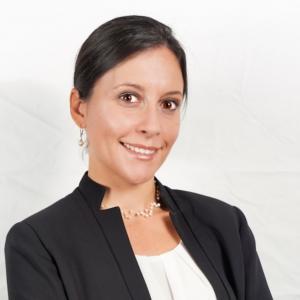 Professional headshot of Tiffany Pendola wearing a white collarless top and black jacket